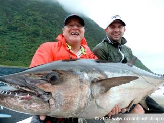 See how happy anglers are when they caught this dogtooth tuna?