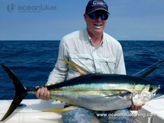 angler showing the yellowfin that he caught