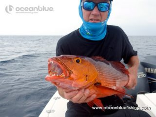 angler with red bass