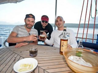 anglers drinking in the boat