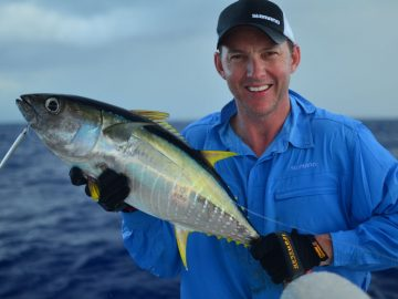 happy angler showing a huge fish