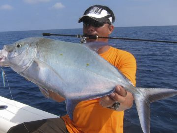 angler holding this huge fish caught in vanuatu