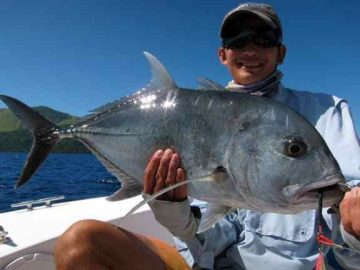 angler with gt fish