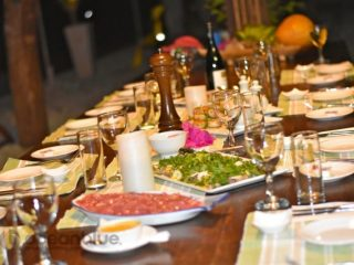 a dinner feast at trees and fishes