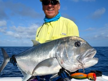five fishing adventurers caught a GT fish