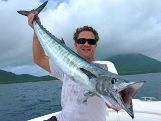 Markus Wunderlich is really happy when he caught this wahoo fish
