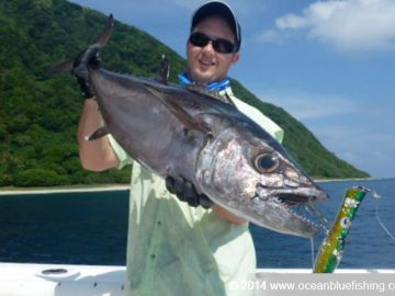 Happy angler with a dogtooth tuna