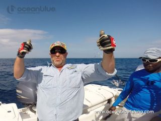 two thumbs up with Ocean Blue Fishing
