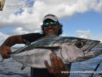 Marco Guarisco holding Dogtooth Tuna