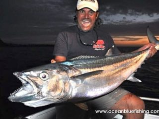Marco Guarisco all smile while holding Dogtooth Tuna