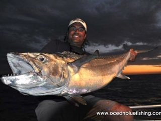 Marco Guarisco holding huge Dogtooth Tuna