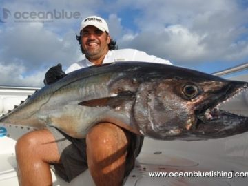 Marco Guarisco showing dogtooth tuna in the boat