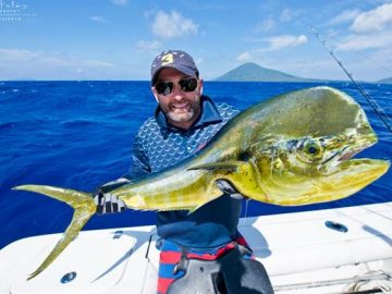 angler with his mahi mahi