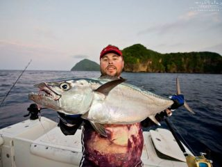 angler enjoying his dogtooth tuna
