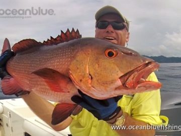 Alan Morrison Mothership Trip: angler holding red bass