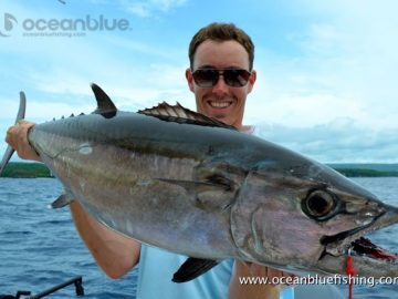 Nature's Way Company: angler holding dogtooth tuna