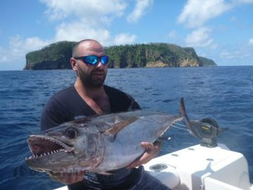 ripper adventure: anglers holding dogtooth tuna