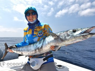 Shefishes wahoo fishing